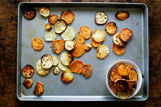 Toasted sweet potatoes on a board.