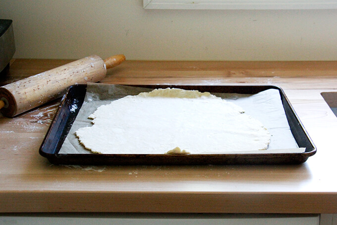 Foolproof food processor pastry dough on a sheet pan lined with parchment paper.