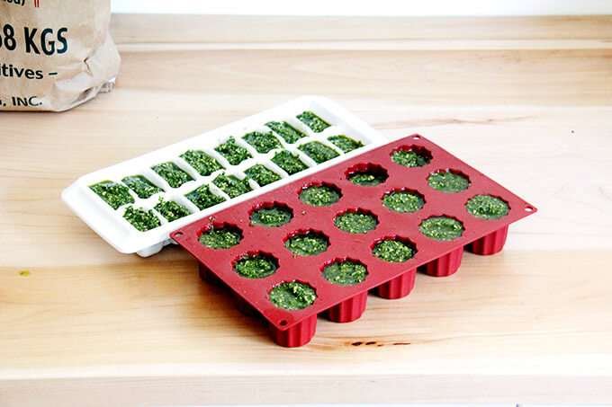 Ice Cube trays filled with basil pesto.