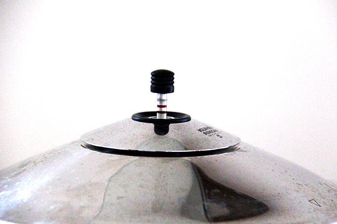 Stovetop pressure cooker at high pressure.