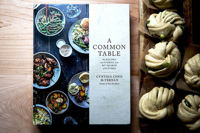 Cynthia McTernan's A Common Table next to un-steamed scallion buns.