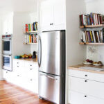 A recently remodeled kitchen with open shelves.