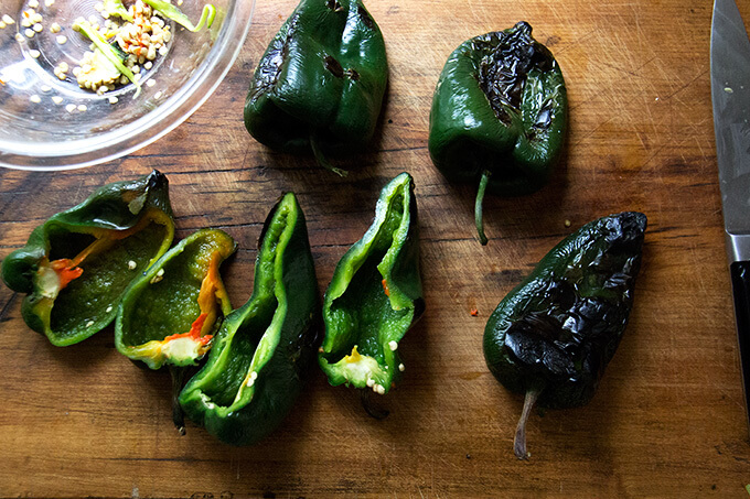 Halved, blistered poblano peppers.
