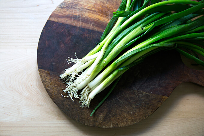 A board with scallions on top.