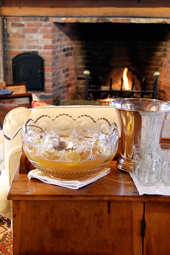 A punch bowl filled with Philadelphia Fish House Punch on a chest.