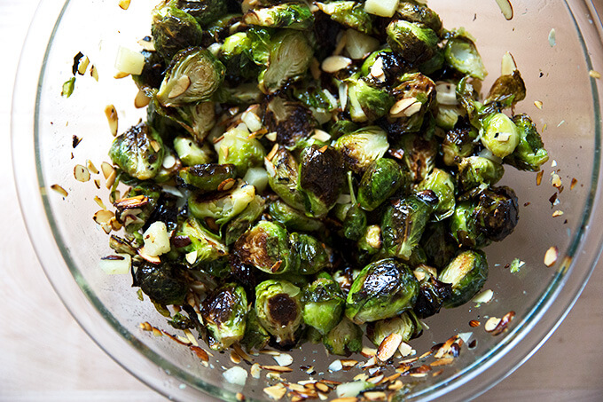 A bowl of roasted Brussels sprouts, almonds, and Manchego all tossed together.