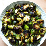 Balsamic Roasted Brussels sprouts with Manchego and almonds in a bowl.