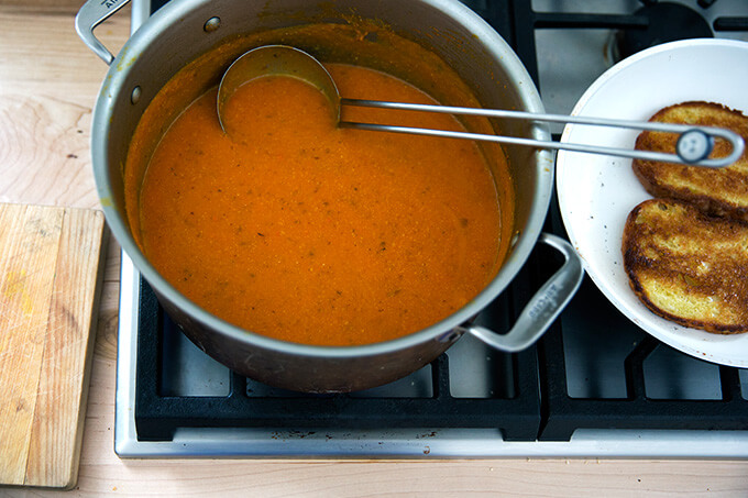 Carrot-saffron soup puréed and ready to eat with olive oil toasted bread.