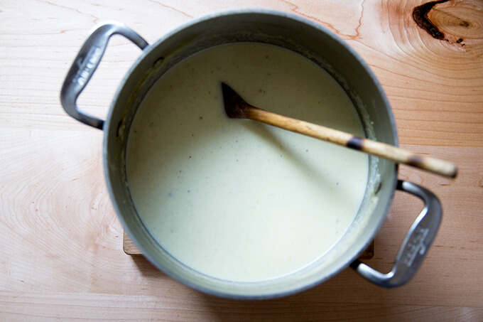 An overhead shot of a pot of cream of celery soup.