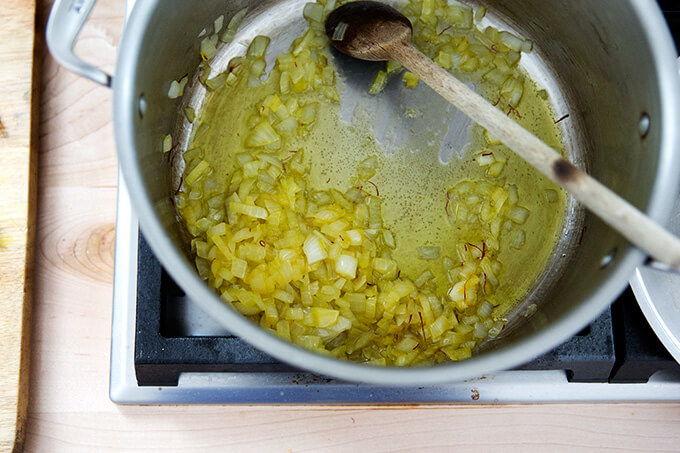 Onions sweating with olive oil and saffron.
