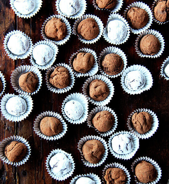An overhead shot of a table lined with boozy chocolate truffles.
