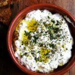 Homemade ricotta with herbs, olive oil, and grilled bread