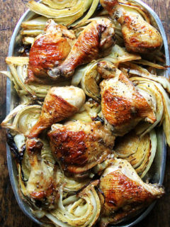 A platter of sheet pan chicken and cabbage.