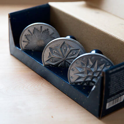 Nordic Ware Starry Night Cookie Stamp Set on a countertop.