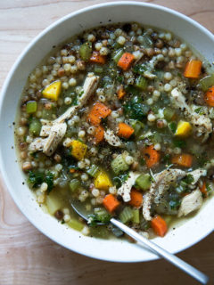 A bowl of simple, homemade chicken soup with fregola.