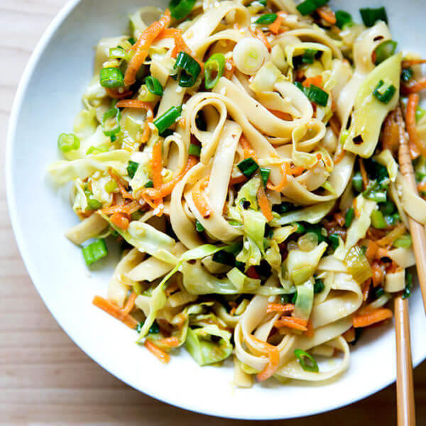 How to make Chinese noodles with chilies, scallions, and cabbage.