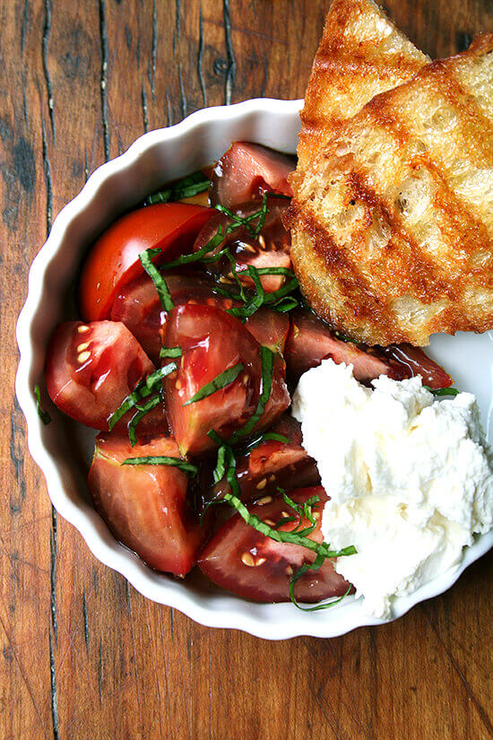 A summer lunch: tomatoes, grilled bread, homemade ricotta