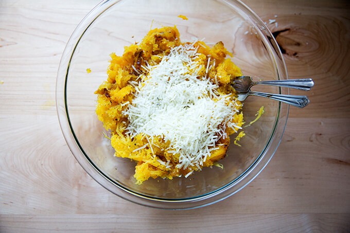 adding the pecorino to the roasted spaghetti squash
