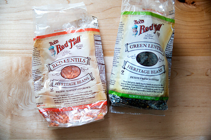 The two bags of lentils used in this recipe: red and French green.