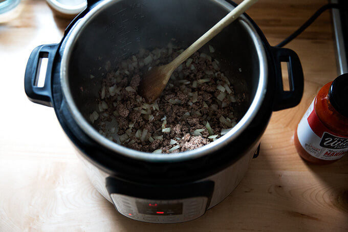 browning the meat and onions in the Instant Pot