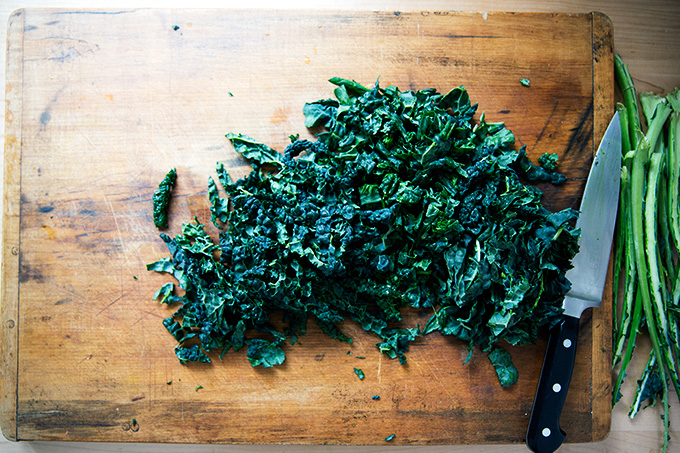 A board with chopped kale.