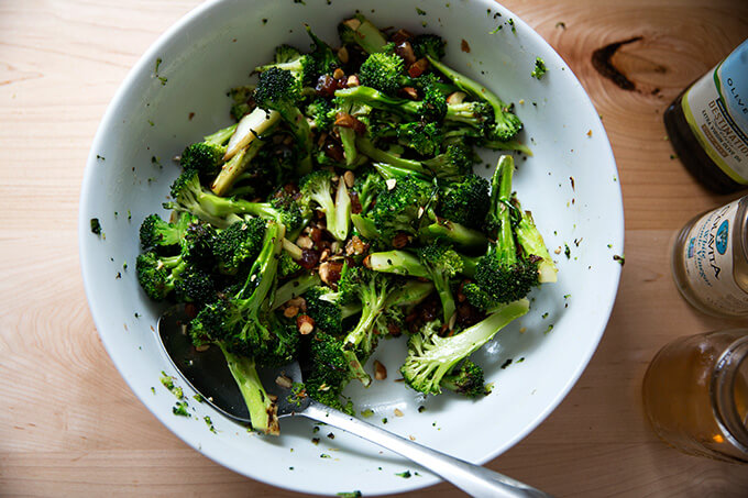 dates and almonds tossed with broccoli