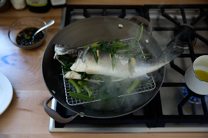 steaming the branzino in the wok