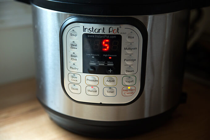 The Instant Pot set to manual, high pressure for 5 minutes, the settings for perfect hard-boiled eggs every time.