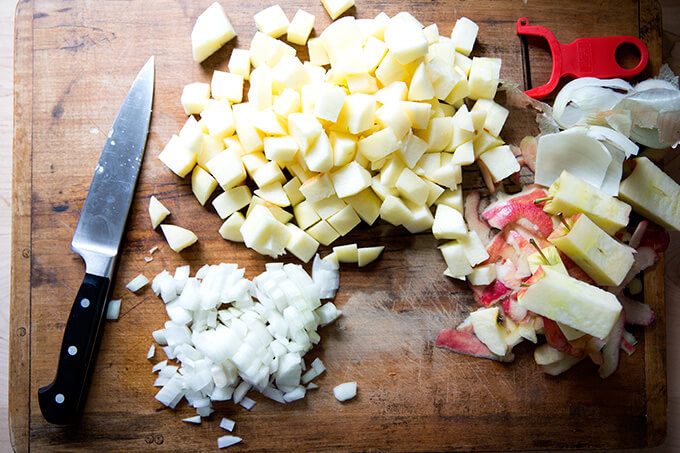 Chopped apples and onions for a homemade apple chutney recipe.
