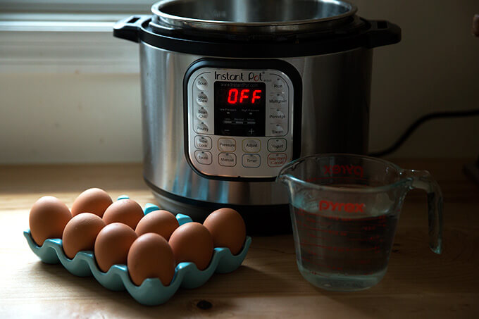 The Instant Pot 6-qt IP Duo with uncooked eggs and water.