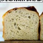 A halved loaf of sourdough sandwich bread.