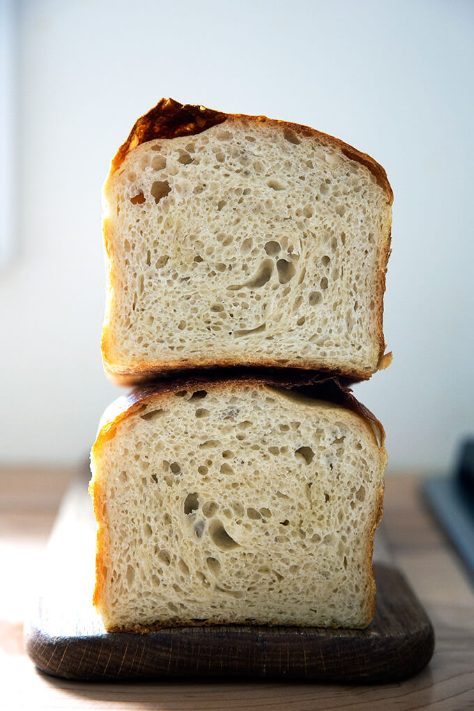 A halved loaf of sourdough sandwich (or toasting) bread.
