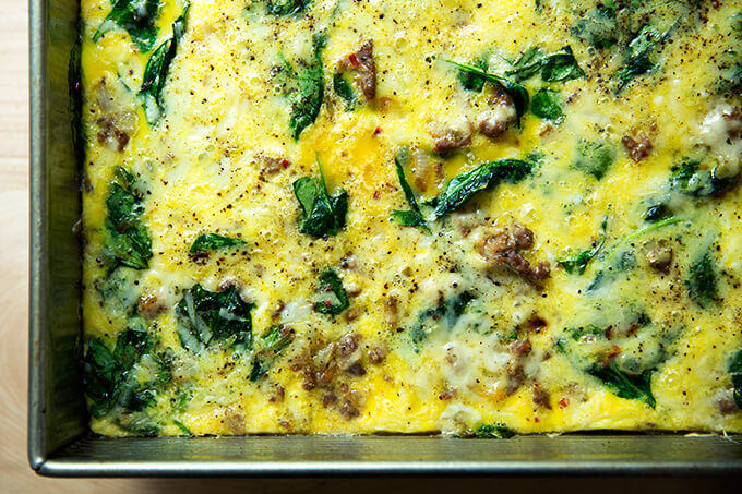A very nice breakfast casserole with eggs, Gruyere, sausage, spinach, and onions.