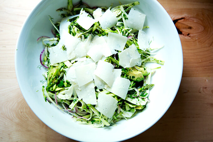 Adding the shaved parm to the shaved fennel salad.