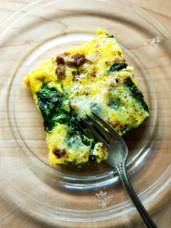 slice of sausage, spinach and egg casserole
