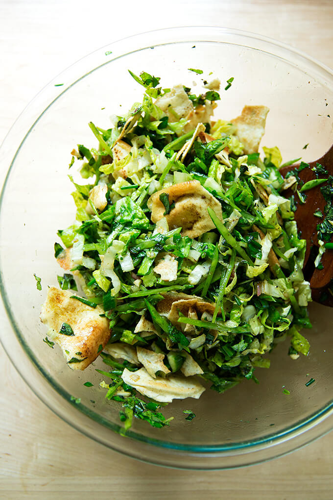 A bowl with a spring fattoush salad all tossed together.
