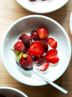 A bowl of strawberries and cream.