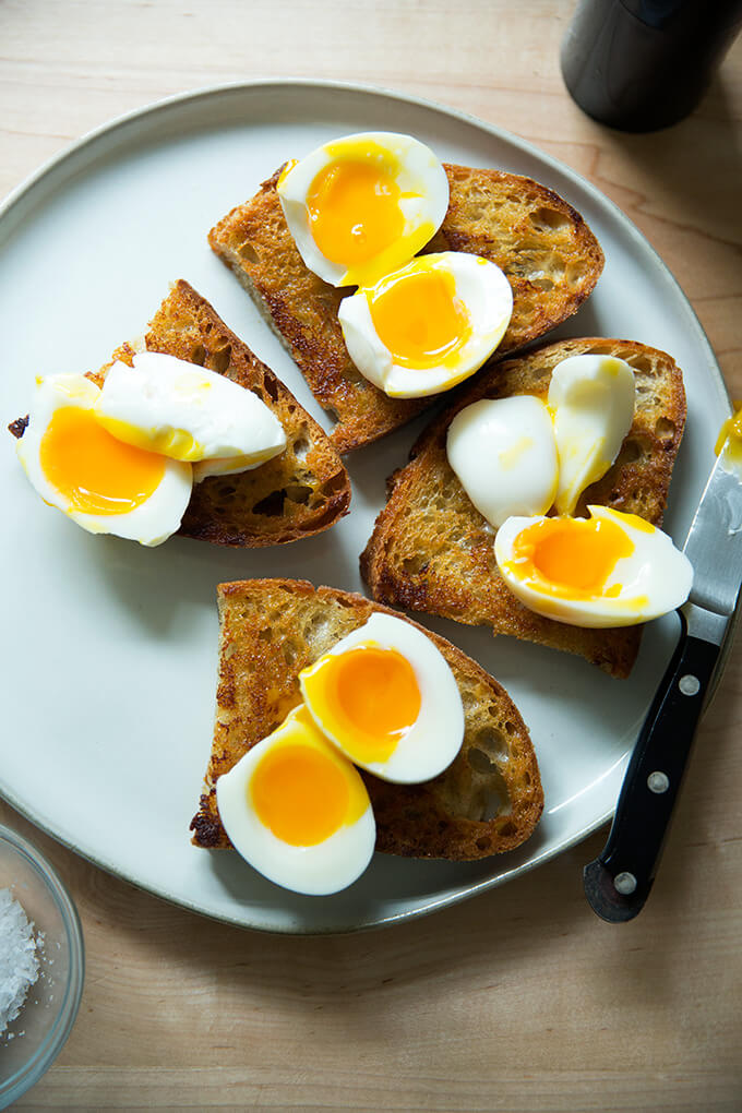 Halved soft-boiled eggs on vinaigrette toast.