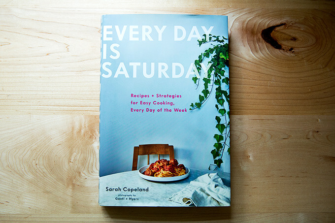 Every Day is Saturday, a cookbook, resting on the counter.