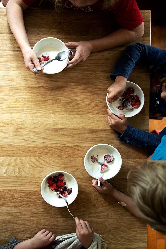 My 4 children eating strawberries + cream