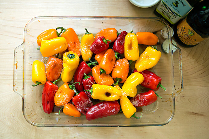 A pan of peppers dressed in olive oil, balsamic, and salt.