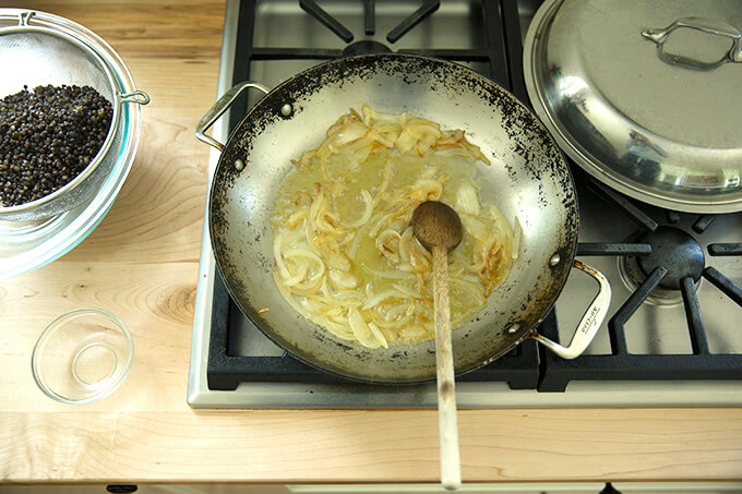 A skillet with sautéed onions and white balsamic.