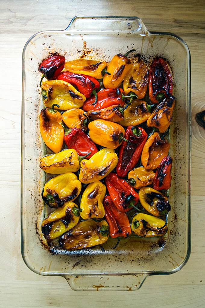 A 9x13-inch pan filled with just-roasted peppers.