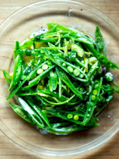 A plate of sugar snap pea salad with buttermilk dressing.