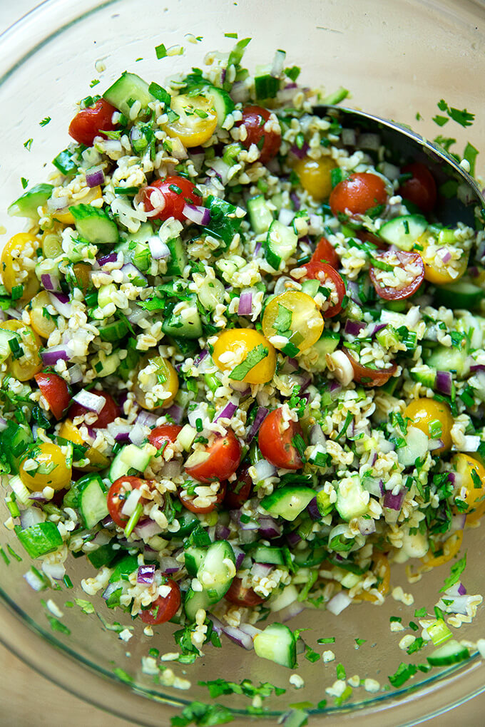 A bowl of tabbouleh all tossed together.
