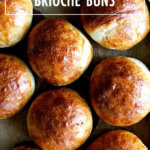 A sheetpan of just-baked brioche buns.