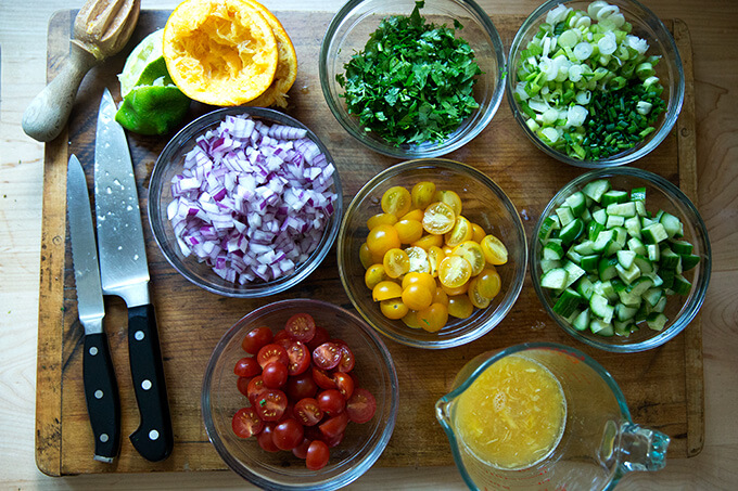 A board with ingredients for tabbouleh, all prepped.