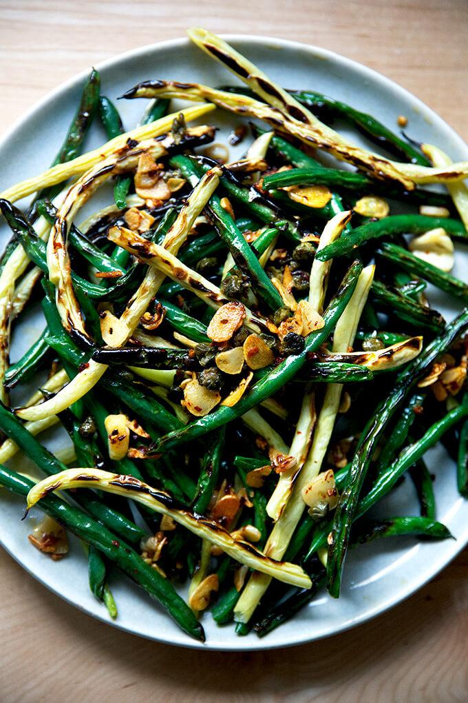 Blistered fresh green beans on a platter.