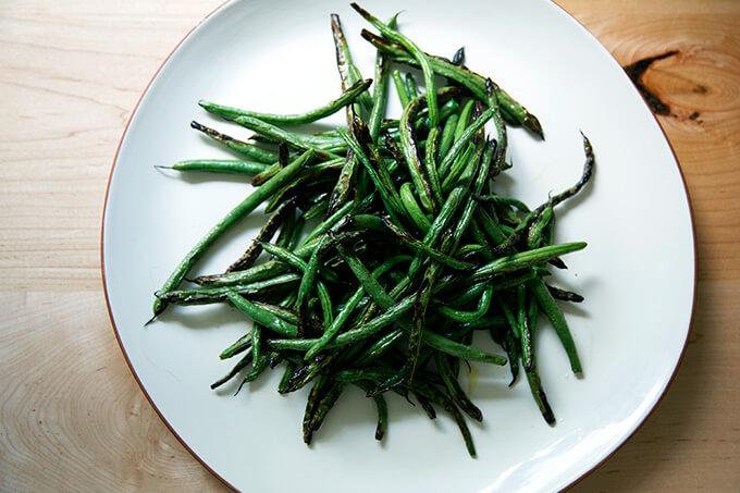 A platter of blistered green beans.