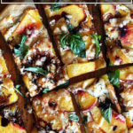 Nectarine, balsamic, and basil pizza cut into pieces.